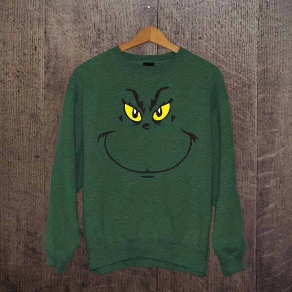 """<p>£11.99,<a href=""""https://www.etsy.com/uk/listing/256825563/the-grinch-xmas-t-shirt-hoodie-or-jumper?ga_order=most_relevant&ga_search_type=all&ga_view_type=gallery&ga_search_query=Christmas%20jumper&ref=sr_gallery_15"""" rel=""""nofollow noopener"""" target=""""_blank"""" data-ylk=""""slk:Etsy"""" class=""""link rapid-noclick-resp""""> Etsy</a></p>"""