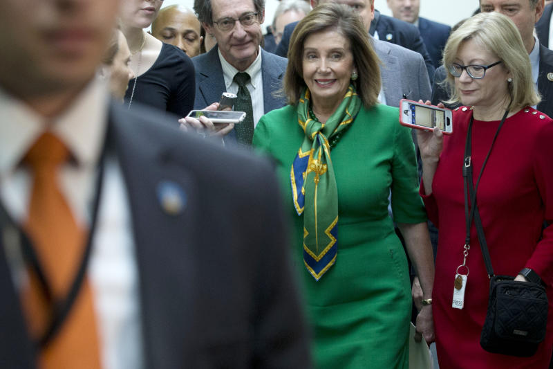 Speaker of the House Nancy Pelosi, D-Calif., leaves a meeting with the Democratic Caucus at the Capitol in Washington, Tuesday, Jan. 14, 2020.  (AP Photo/Jose Luis Magana)