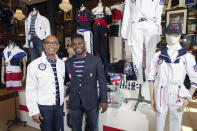 FILE - Olympic medalists in fencing, Peter Westbrook, left, and Daryl Homer model the Team USA Tokyo Olympic opening ceremony uniforms at the Ralph Lauren SoHo store on Wednesday, July 7, 2021, in New York. Olympic gear makes for lively social media fodder, starting with the hours-long Parade of Nations. The year's wait due to the pandemic has given enthusiasts extra time to ponder what they love or hate. (Photo by Charles Sykes/Invision/AP, File)