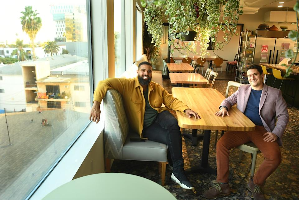 Prophet Walker, left, and Joe Green in a communal space at Treehouse. Every Sunday, residents gather here for a shared meal.