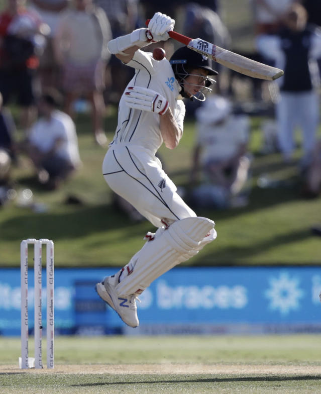 New Zealand's Mitchell Santner fends at ball from England's Ben Stokes during play on day three of the first cricket test between England and New Zealand at Bay Oval in Mount Maunganui, New Zealand, Saturday, Nov. 23, 2019. (AP Photo/Mark Baker)