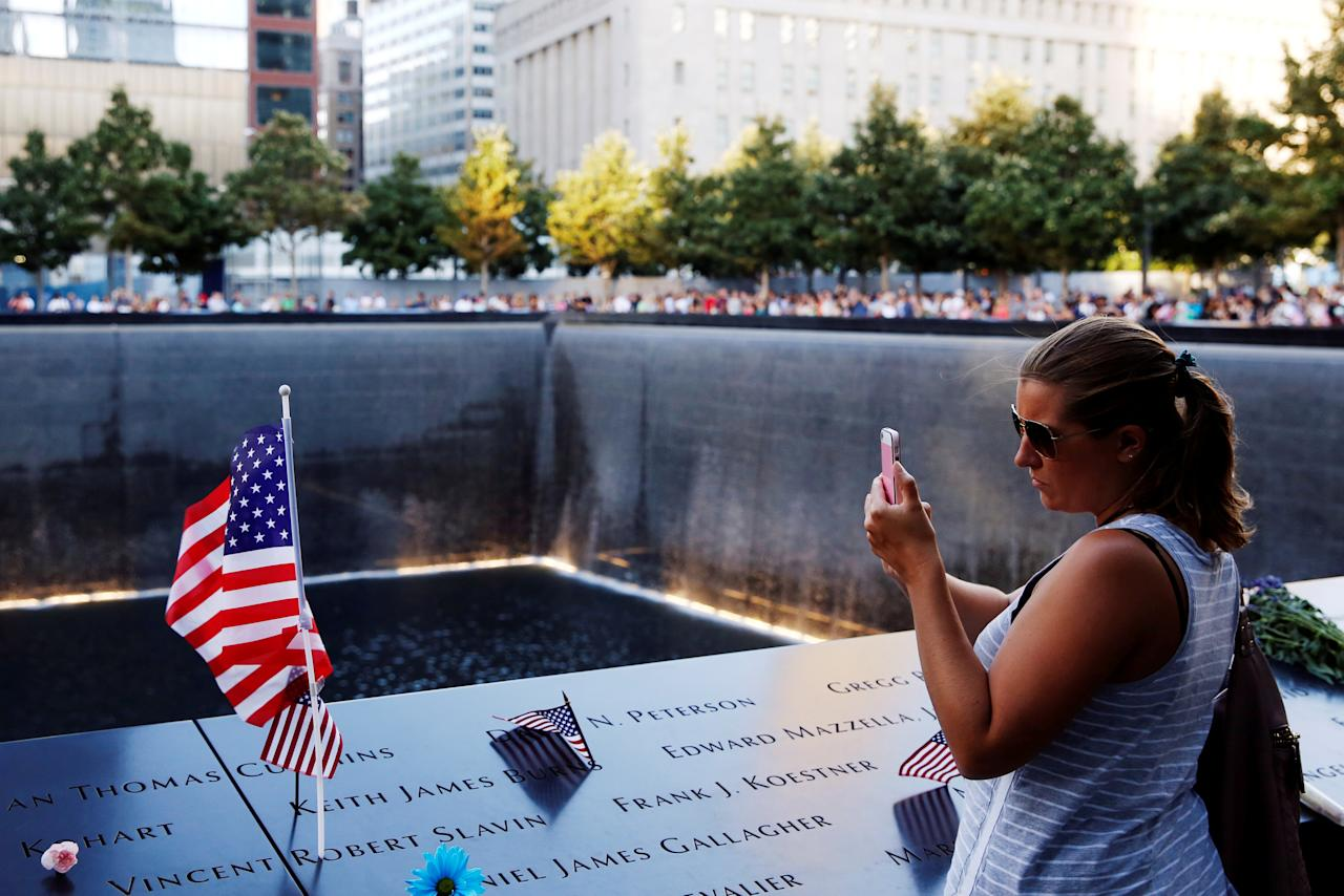 FILE PHOTO:  A visitor photographs the National September 11 Memorial and Museum on the 15th anniversary of the 9/11 attacks in Manhattan, New York, U.S. on September 11, 2016.  REUTERS/Lucas Jackson/File Photo