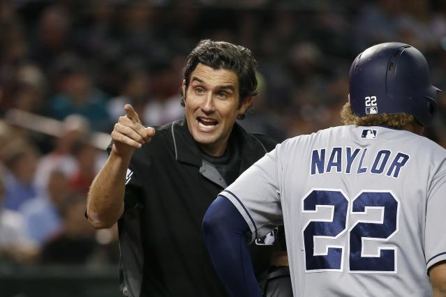 Umpire John Tumpane, left, shouts at San Diego Padres' Manny Machado to stop arguing balls-and-strikes as Padres' Josh Naylor steps in to bat during the fourth inning of the team's baseball game against the Arizona Diamondbacks on Wednesday, Sept. 4, 2019, in Phoenix. (AP Photo/Ross D. Franklin)