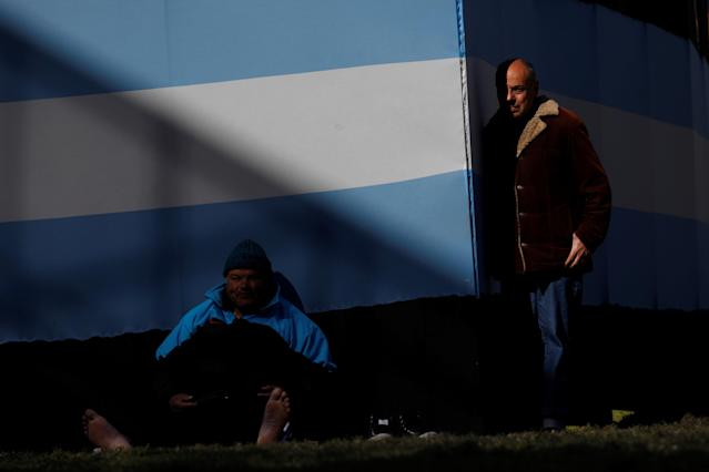 Argentina fans watch a broadcast of the World Cup Group D Nigeria v Iceland soccer match, at a public viewing area at a square in Buenos Aires, Argentina, June 22, 2018. REUTERS/Martin Acosta