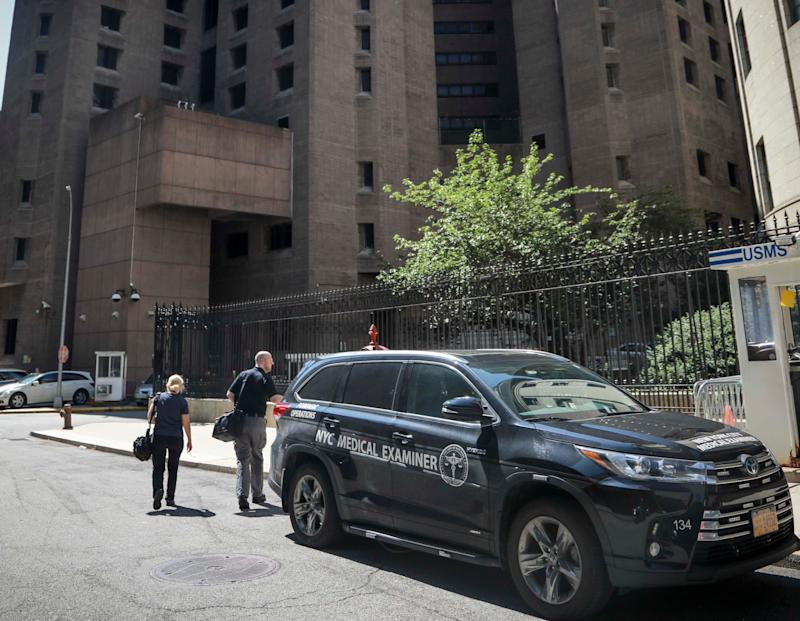 New York City medical examiner personnel leave their vehicle and walk to the Manhattan Correctional Center where financier Jeffrey Epstein died by suicide while awaiting trial on sex-trafficking charges, Saturday Aug. 10, 2019, in New York.