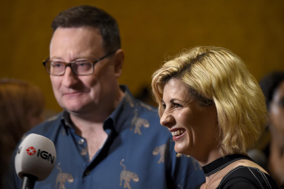 """Chris Chibnall, left, and Jodie Whittaker arrive at the """"Doctor Who"""" press line on day one of Comic-Con International on Thursday, July 19, 2018, in San Diego. (Photo by Chris Pizzello/Invision/AP)"""