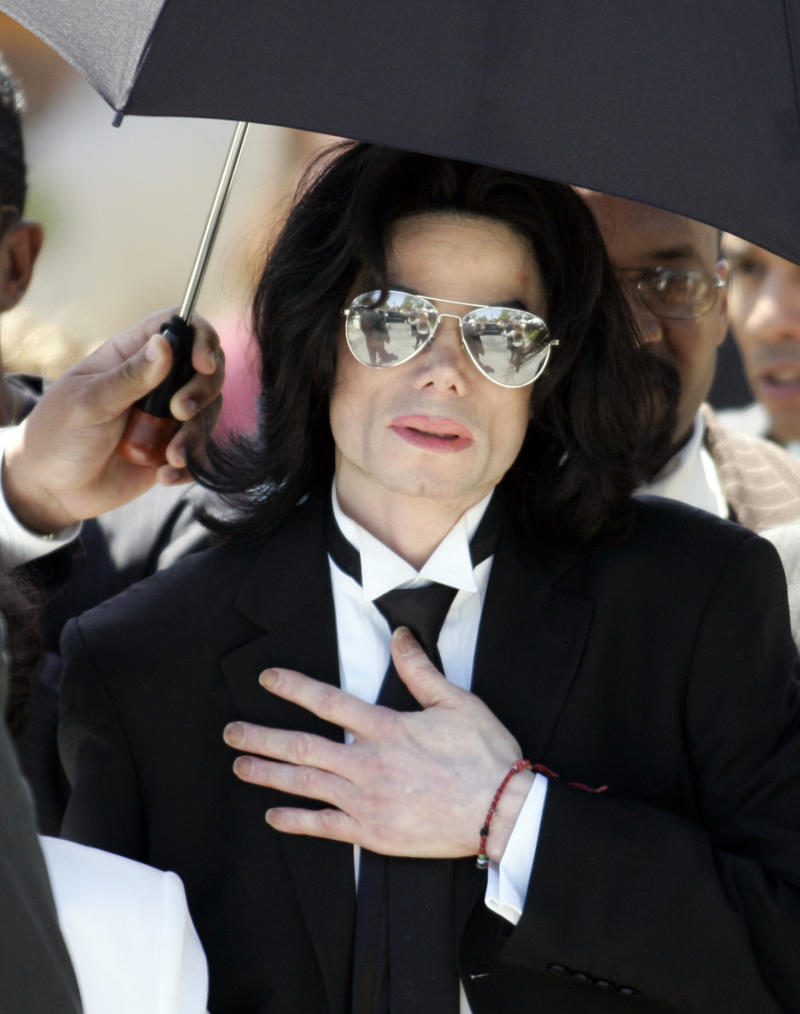 Michael Jackson leaves the Santa Barbara County Courthouse after not guilty verdict for child molestation in Santa Maria. A relieved Michael Jackson leaves the Santa Barbara County Courthouse after being found not guilty on all ten counts of child molestation in Santa Maria, California June 13, 2005. Jackson was found not guilty on Monday of molesting a 13 year-old boy in 2003 and was acquitted of conspiracy and alcohol charges. REUTERS/Gene Blevins Pictures of the Year 2005