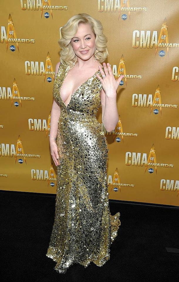 """Another singer who went glam was Kellie Pickler, who made the mistake of pairing her paillette-covered dress with Farrah Fawcett-like locks and pale-pink makeup, resulting in an age-inappropriate look for the 24-year-old. Michael Loccisano/<a href=""""http://www.wireimage.com"""" target=""""new"""">WireImage.com</a> - November 10, 2010"""