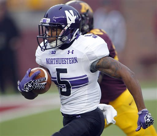 Northwestern running back Venric Mark runs for a touchdown on the first play of the game against Minnesota during the first half of an NCAA college football game in Minneapolis Saturday, Oct. 13, 2012.(AP Photo/Andy King)