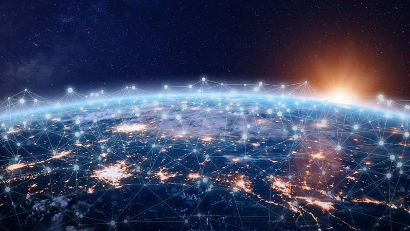 Image of the world from space lit up by communication and technology towers