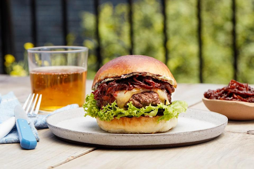 "This luxe burger gets its umami-packed richness from dry-aged steak. Yep, you read that right, we grind beautiful steaks to make a burger. One bite of the juicy patty, steak sauce–flavored onions, and rich herb butter (inspired by <a href=""http://www.epicurious.com/recipes/food/views/bearnaise-sauce-395049?mbid=synd_yahoo_rss"" rel=""nofollow noopener"" target=""_blank"" data-ylk=""slk:Béarnaise sauce"" class=""link rapid-noclick-resp"">Béarnaise sauce</a>, a classic steak condiment) and you'll know it's worth every penny. <a href=""https://www.epicurious.com/recipes/food/views/steakburger-with-tangy-caramelized-onions-and-herb-butter?mbid=synd_yahoo_rss"" rel=""nofollow noopener"" target=""_blank"" data-ylk=""slk:See recipe."" class=""link rapid-noclick-resp"">See recipe.</a>"