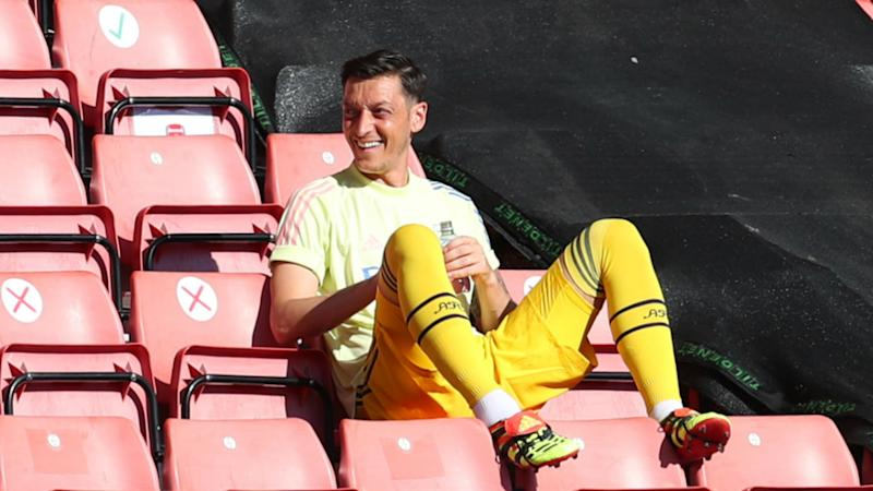 Ozil wants to stay at Arsenal despite exit rumours