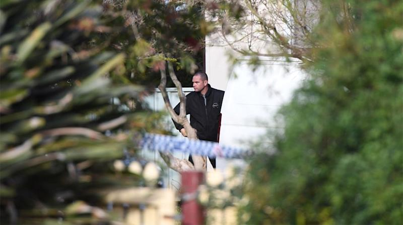NSW Police contractors prepare to take the body of a three-year old girl who was fatally shot from a house in Lalor Park in western Sydney. Source: AAP