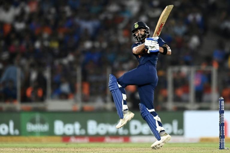 Back in business: India captain Virat Kohli hits a boundary to win the second Twenty20 international