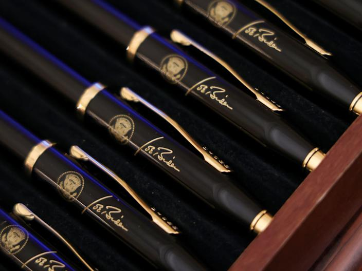 Box of U.S. President Biden pens is seen at the White House in Washington A box of pens with the presidential seal and the signature of U.S. President Joe Biden is seen on display at the White House in Washington, U.S., January 21, 2021.