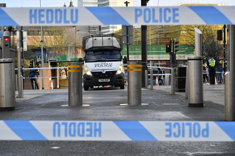 <p>Cordons remained in place in Queen Street on Sunday morning</p>PA