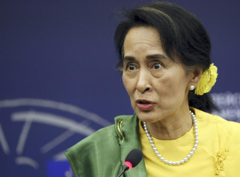 Aung San Suu Kyi, Myanmar's Nobel Peace Prize laureate and long-time political prisoner, answers reporters after finally receiving the European Union's 1990 Sakharov Prize for human rights at the European parliament in Strasbourg, eastern France, Tuesday Oct 22, 2013. Suu Kyi has persevered for decades in promoting democracy. She and her National League for Democracy party were frozen out of politics by the military regime that governed until 2011, and last year she and several dozen party members won parliamentary seats. (AP Photo/Christian Lutz)