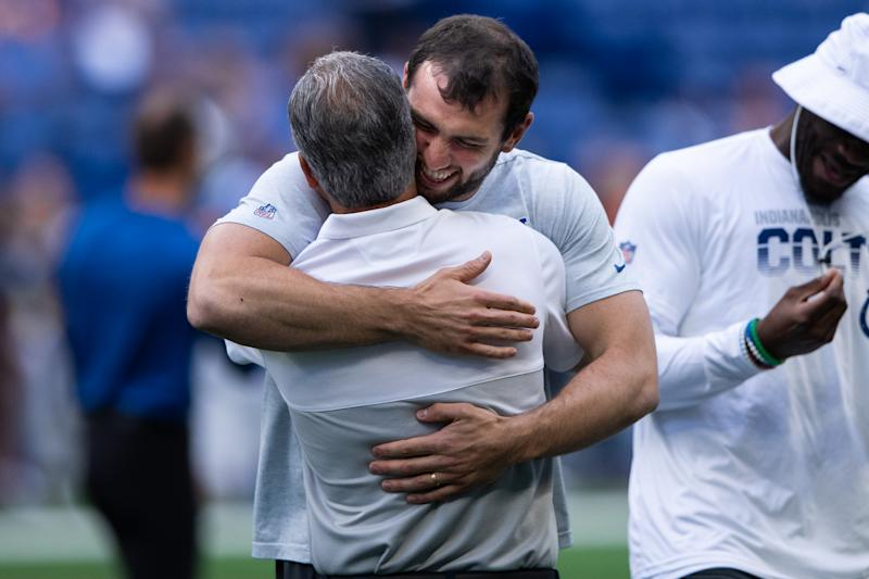 INDIANAPOLIS, IN - AUGUST 24: Chicago Bears defensive coordinator Chuck Pagano talks to Indianapolis Colts quarterback Andrew Luck (12) before the week 3 NFL preseason game between the Chicago Bears and Indianapolis Colts on August 24, 2019 at Lucas Oil Stadium, in Indianapolis, IN. (Photo by Zach Bolinger/Icon Sportswire via Getty Images)