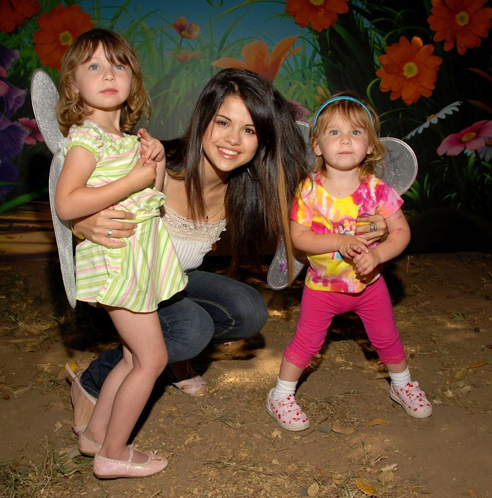 <p>Selena posed with a pair of young fans at an AIDS benefit event in LA.</p>