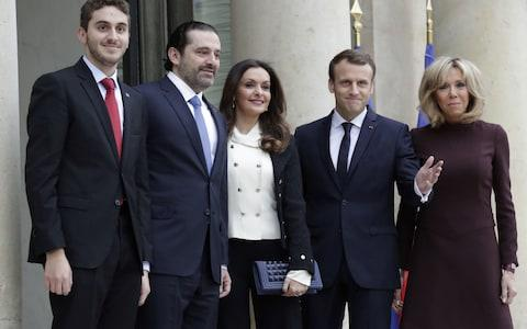 French President Emmanuel Macron (4R) and his wife Brigitte Macron (R) welcome Lebanese Prime Minister Saad Hariri (2R), his wife Lara Bachir El-Alzm (3R) and their son Houssam (L) - Credit: AFP