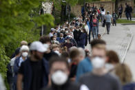 FILE - In this Saturday, May 15, 2021 file photo, people queue at a vaccination centre in Ebersberg near Munich, Germany, Germany's health minister Jens Spahn says today the country has now given a first coronavirus vaccine shot to more than half of its population. (AP Photo/Matthias Schrader, file)