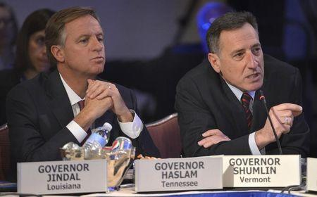 Vermont Democratic Governor Shumlin asks question as Tennessee Republican Governor Haslam listens during National Governors Association Winter Meeting in Washington