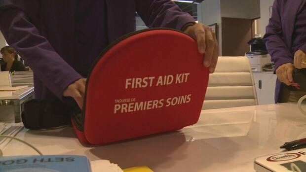 International Avenue ambassadors are equipped with first aid and naloxone kits and have mental health and other training. (Helen Pike/CBC - image credit)