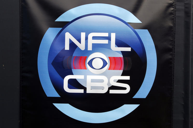 FILE - In this Nov. 13, 2011, file photo, an NFL on CBS sign is displayed before an NFL football game pitting the Tennessee Titans against the Carolina Panthers in Charlotte, N.C. There's been no reported progress in negotiations between CBS Corp. and Time Warner, which has blocked CBS programming from its customers' homes in Dallas, Los Angeles and New York since Aug. 2. Meanwhile, Time Warner customers caught in the middle will miss third and fourth round competition in the U.S. Open tennis tournament. The tournament's finals are next weekend, along with opening weekend in the National Football League. (AP Photo/Bob Leverone, File)