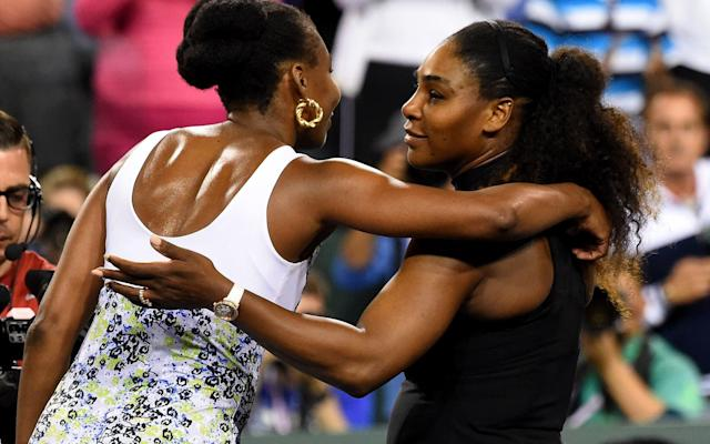Venus Williams and Serena Williams hug after their third round match - USA TODAY Sports