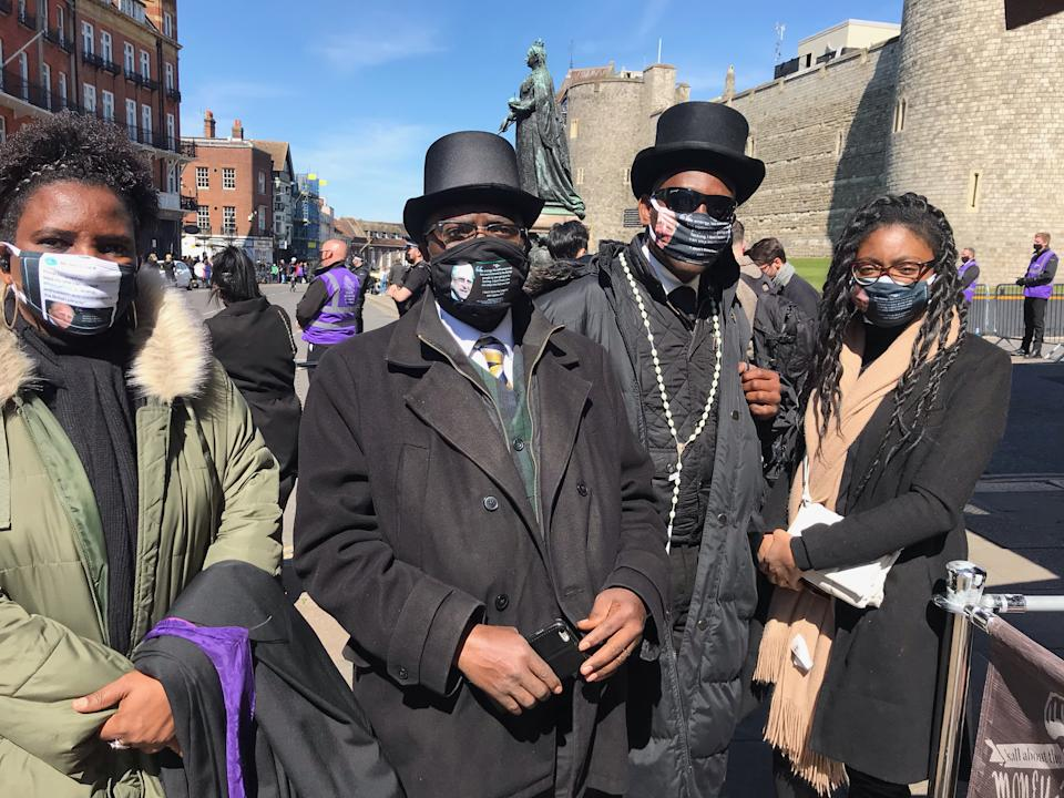 <p>Professor Chris Imafidon, second from left, who says he met the Duke on a few occasions, spoke of his dismay that crowds were not allowed gather at Windsor Castle for the funeral. (PA)</p>