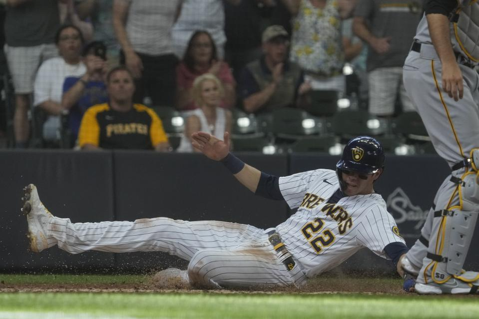 Milwaukee Brewers' Christian Yelich scores from first on a hit by Omar Narvaez during the third inning of a baseball game against the Pittsburgh Pirates Saturday, June 12, 2021, in Milwaukee. (AP Photo/Morry Gash)