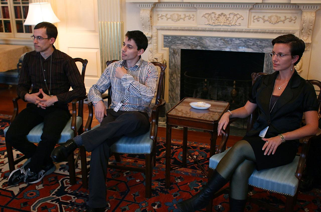 WASHINGTON, DC - OCTOBER 13:  Hikers Shane Bauer (L) , Josh Fattal (C) and Sarah Shroud (R) attend a meeting at the State Department October 13, 2011 in Washington, DC. Secretary of State Hillary Clinton briefly met with the hikers who were detained in Iran, Shroud for 14 months, Bauer and Fattal for over two years.  (Photo by Mark Wilson/Getty Images)