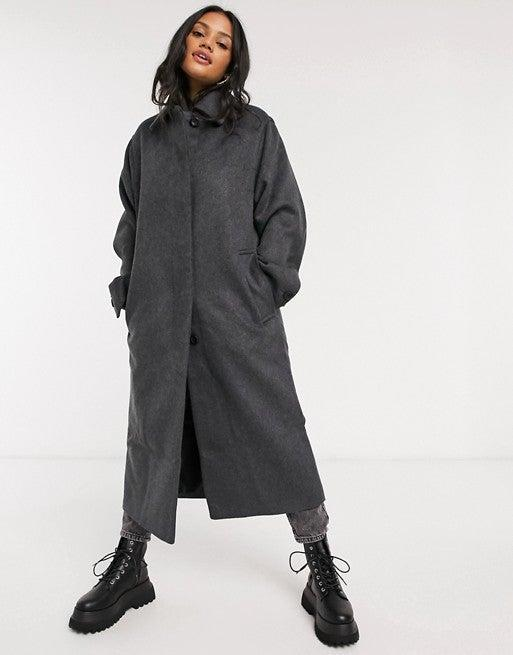 "<br><br><strong>ASOS DESIGN</strong> Button Through Coat, $, available at <a href=""https://go.skimresources.com/?id=30283X879131&url=https%3A%2F%2Fwww.asos.com%2Fus%2Fasos-design%2Fasos-design-button-through-coat-in-dark-gray%2Fprd%2F14738128"" rel=""nofollow noopener"" target=""_blank"" data-ylk=""slk:ASOS"" class=""link rapid-noclick-resp"">ASOS</a>"