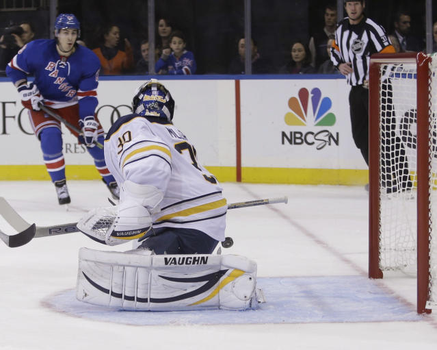 Buffalo Sabres goalie Ryan Miller (30) attempts to stop a shot by New York Rangers' Chris Kreider as Brad Richards (19) watches during the second period of an NHL hockey game Thursday, Oct. 31, 2013, in New York. Kreider scored on the play. (AP Photo/Frank Franklin II)