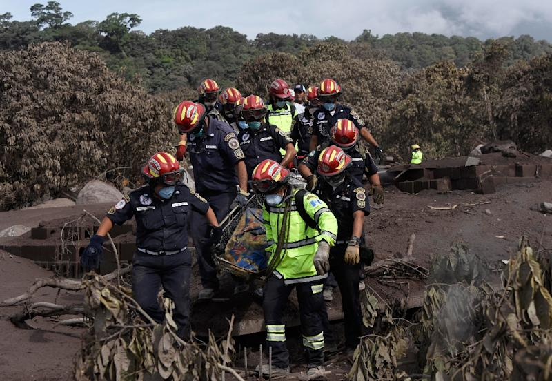 Emergency personnel retrieve the body of a victim of the volcanic eruption in Guatemala -- so far, at least 99 people are known to have died