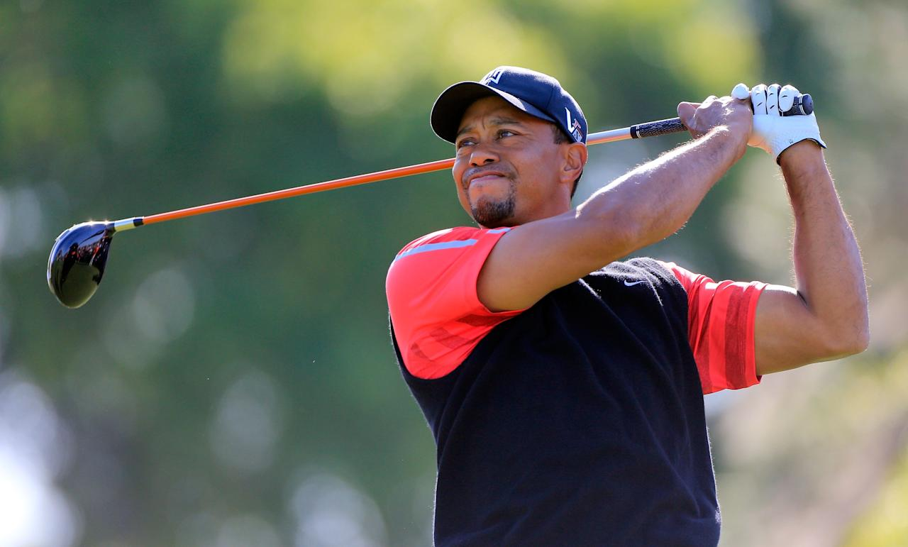 ORLANDO, FL - MARCH 25:  Tiger Woods plays a shot on the 5th hole during the final round of the Arnold Palmer Invitational presented by MasterCard at the Bay Hill Club and Lodge on March 25, 2013 in Orlando, Florida.  (Photo by Sam Greenwood/Getty Images)