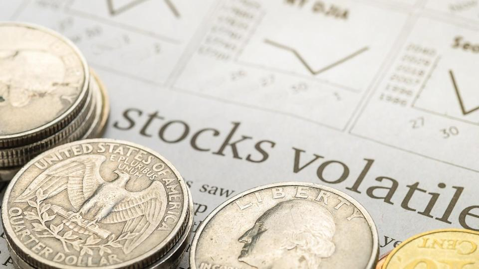 stack of coins with stocks document