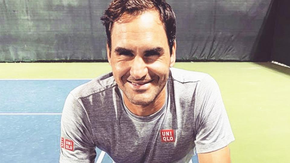 Roger Federer (pictured) leaning on the net after practice.