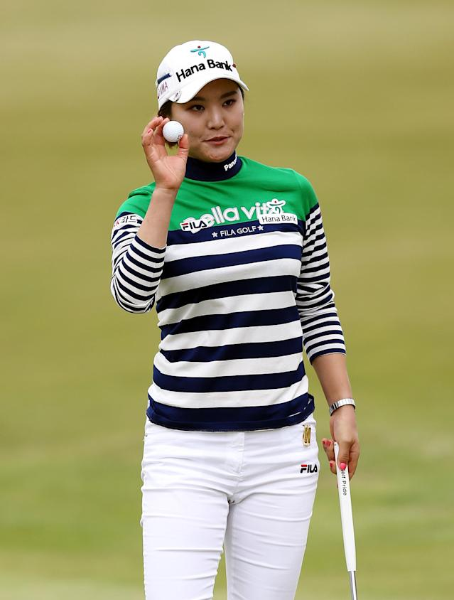 South Korea's So Yeon Ryu holds up her ball after putting on the 18th green during the third day of the Women's British Open golf championship at the Royal Birkdale Golf Club, Southport, England, Saturday July 12, 2014. (AP Photo/Scott Heppell)
