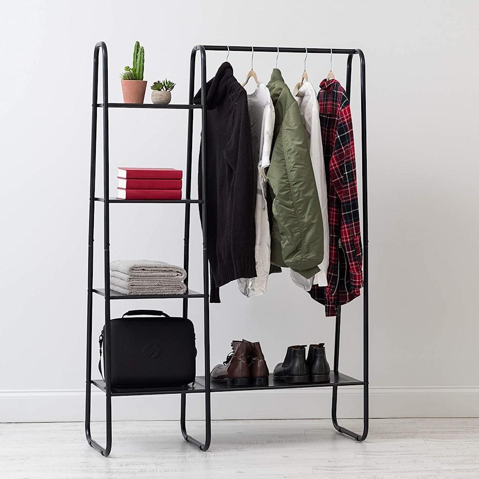 <p>Running out of closet space? No problem, get this <span>Iris Garment Rack With Metal Mesh Shelves</span> ($80).</p>