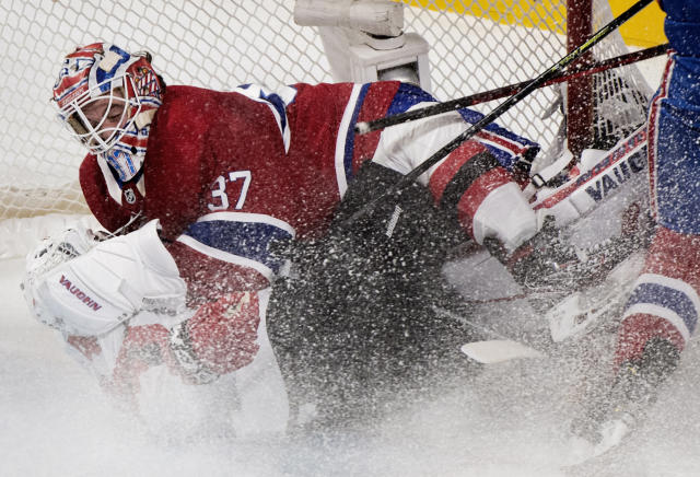 New Jersey Devils' Miles Wood (44) slides in on Montreal Canadiens goaltender Keith Kinkaid during the first period of an NHL hockey game in Montreal, Saturday, Nov. 16, 2019. (Graham Hughes/The Canadian Press via AP)