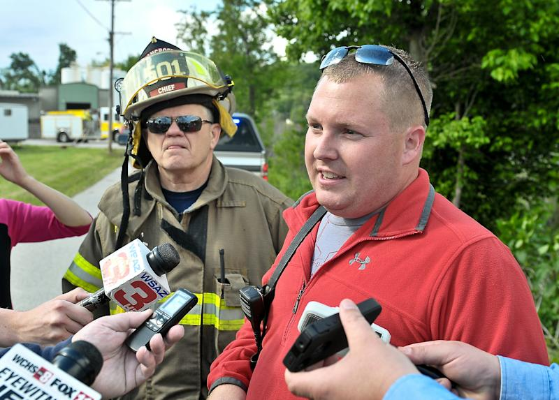 Bancroft Fire Department Chief Harris and Firefighter Chad Jones explain the series of events surrounding the explosion at the Putnam County Airgas Facility in Black Betsy, W.Va., Monday afternoon, May 13, 2013. (AP Photo/Daily Mail, Bob Wojcieszak)