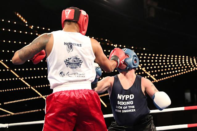 "<p>NYPD police officer called ""Spiderman"" connects with a right on Mike Alba, left, during the NYPD Boxing Championships at the Theater at Madison Square Garden on June 8, 2017. (Photo: Gordon Donovan/Yahoo News) </p>"