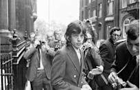 <p>Surrounded by press photographers, Mick Jagger arrives at the London law courts to appeal against his conviction on drug charges. His sentence was reduced from three months imprisonment to conditional discharge with probation, 1967.</p>