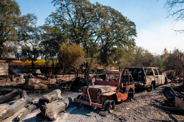 The charred remains of vehicles sit on a property burned during the Kincade Fire, along Highway 128 at in Healdsburg on Oct. 28.