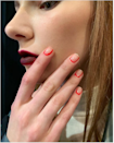 Turn a French mani on its head and accent your cuticles instead of the tips. The negative space still makes your nails look extra long; it's just a little edgier, especially in a neon red.