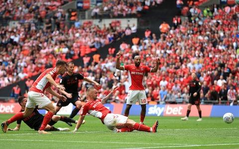 harlton Athletic's Patrick Bauer (centre) scores his side's second goal of the game during the Sky Bet League One Play-off final at Wembley - Credit: Mike Egerton/PA Wire