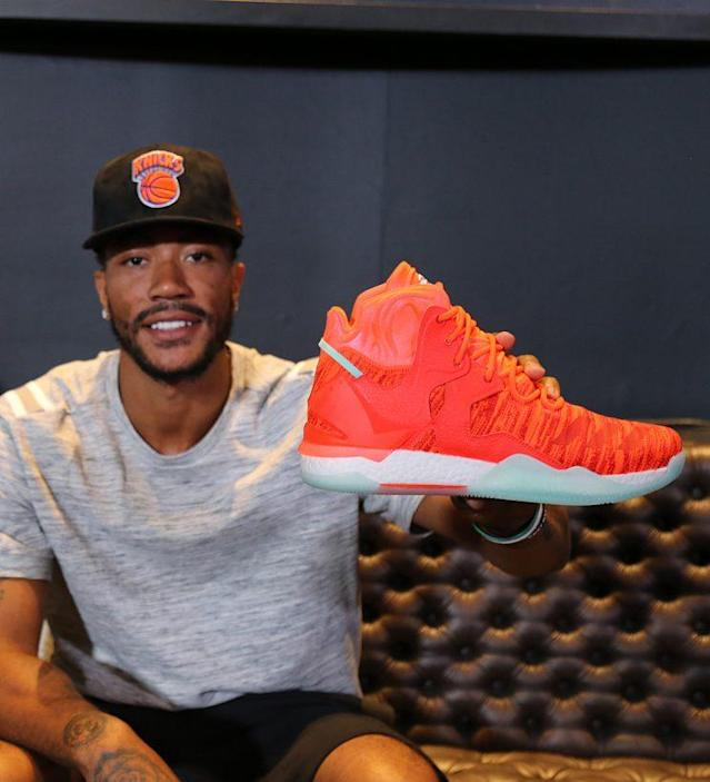 Rose holds up his new D Rose 7 shoe. (Nick DePaula)