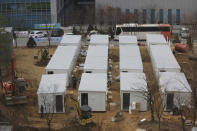 FILE - In this Dec. 10, 2020, file photo, containers to be used as a ward to treat people infected with the coronavirus are set up on the grounds of the Seoul Medical Center in Seoul, South Korea. South Korea had seemed to be winning the fight against the coronavirus: Quickly ramping up its testing, contact-tracing and quarantine efforts paid off when it weathered an early outbreak without the economic pain of a lockdown. But a deadly resurgence has reached new heights during Christmas week, prompting soul-searching on how the nation sleepwalked into a crisis. (AP Photo/Ahn Young-joon, File)