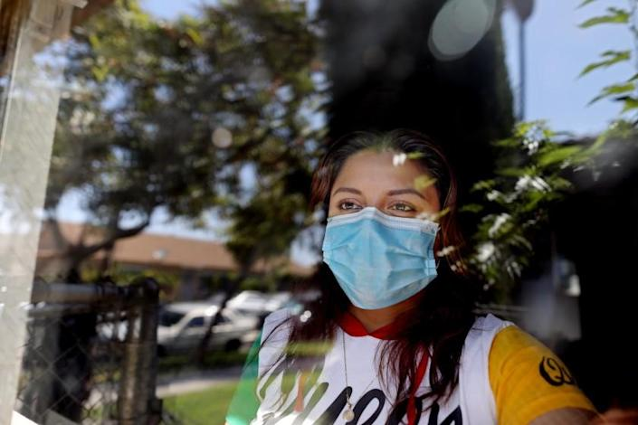 """Certified nursing assistant Rosa Arenas has been home quarantining since May 2 after testing positive for COVID-19 at her apartment in Orange. <span class=""""copyright"""">(Gary Coronado / Los Angeles Times)</span>"""